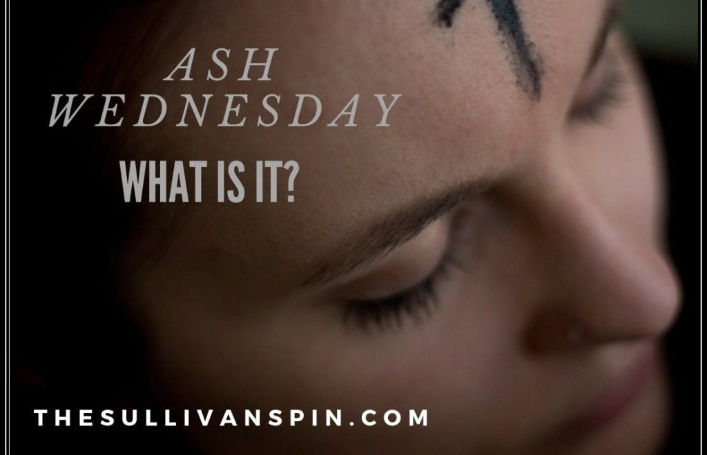 A woman receives the sign of the cross in ashes on Ash Wednesday