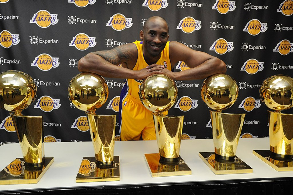 Kobe Bryant surrounded by his 5 NBA Championships