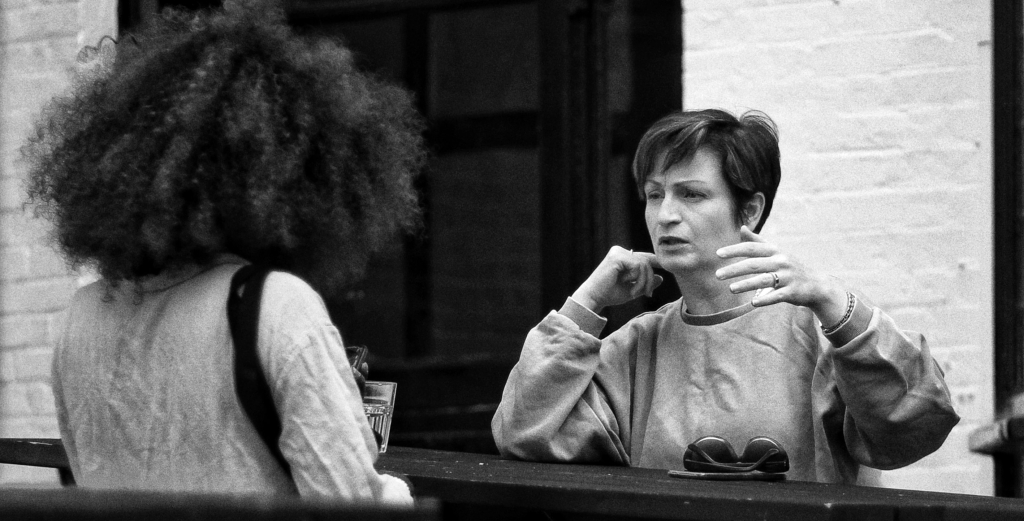 Two women having a conversation about moralistic therapeutic deism.